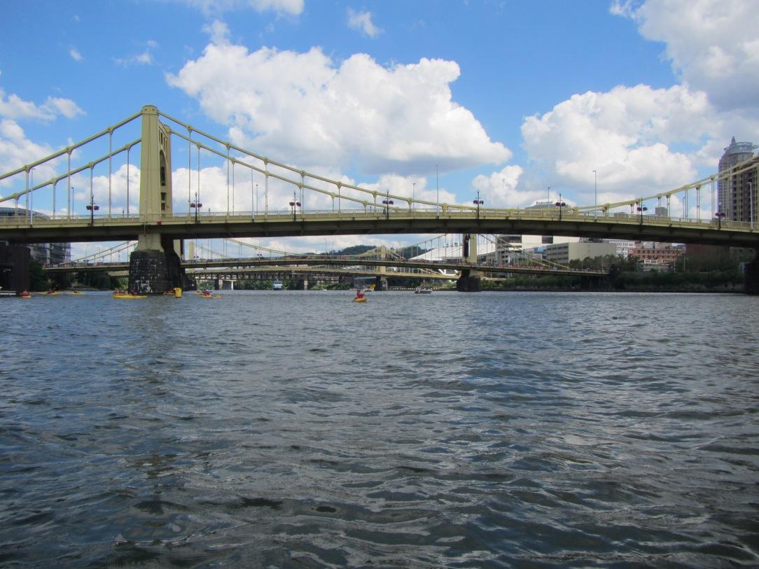 Paddling under one of Pittsburgh's many bridges.