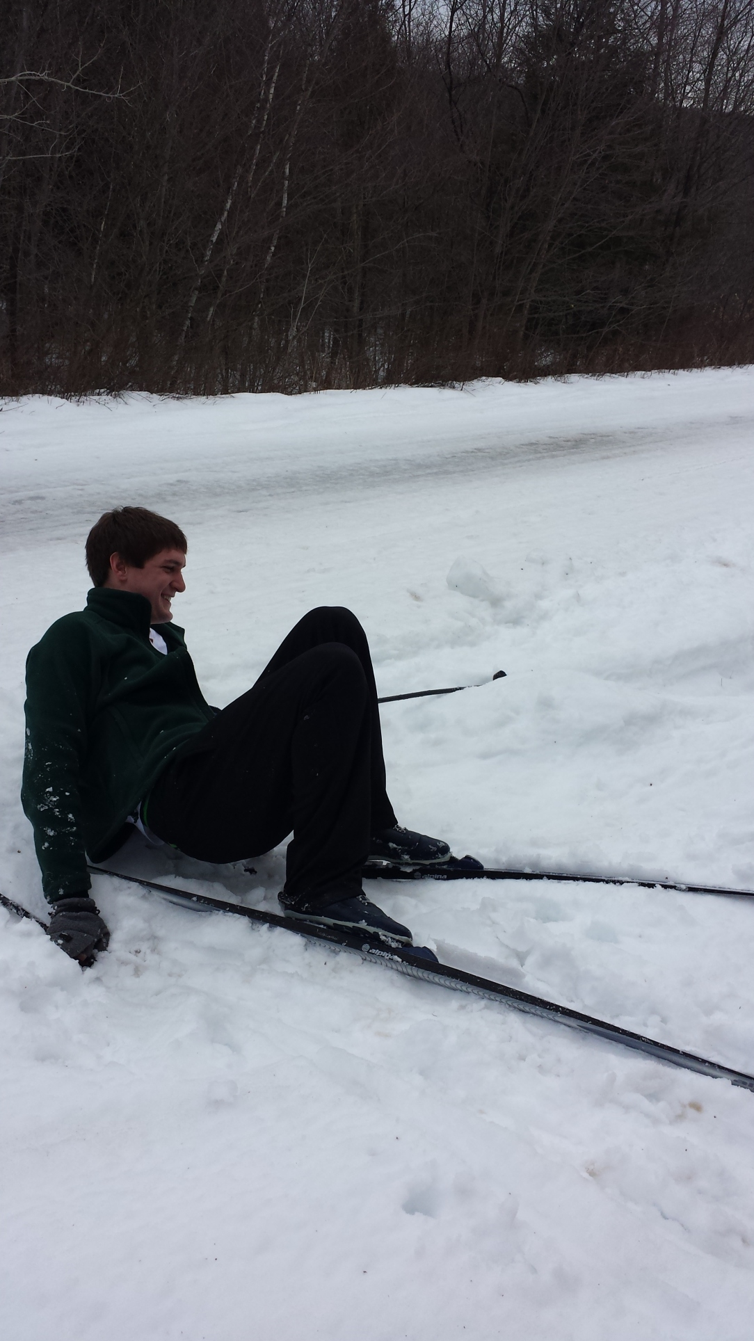 This is my cousin Mikey who I was XC skiing with last weekend. He makes fun of me for blogging. I'm retaliating by posting a picture of him rolling around in the snow.