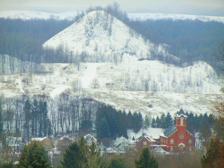 "Simpson, Pennsylvania's ""Mechanical Mountain,"" a relic of the coal mining the once dominated the region. I know it as somewhere we used to hike every summer growing up and the ever present backdrop to St. Mike's church, in the lower right hand corner."