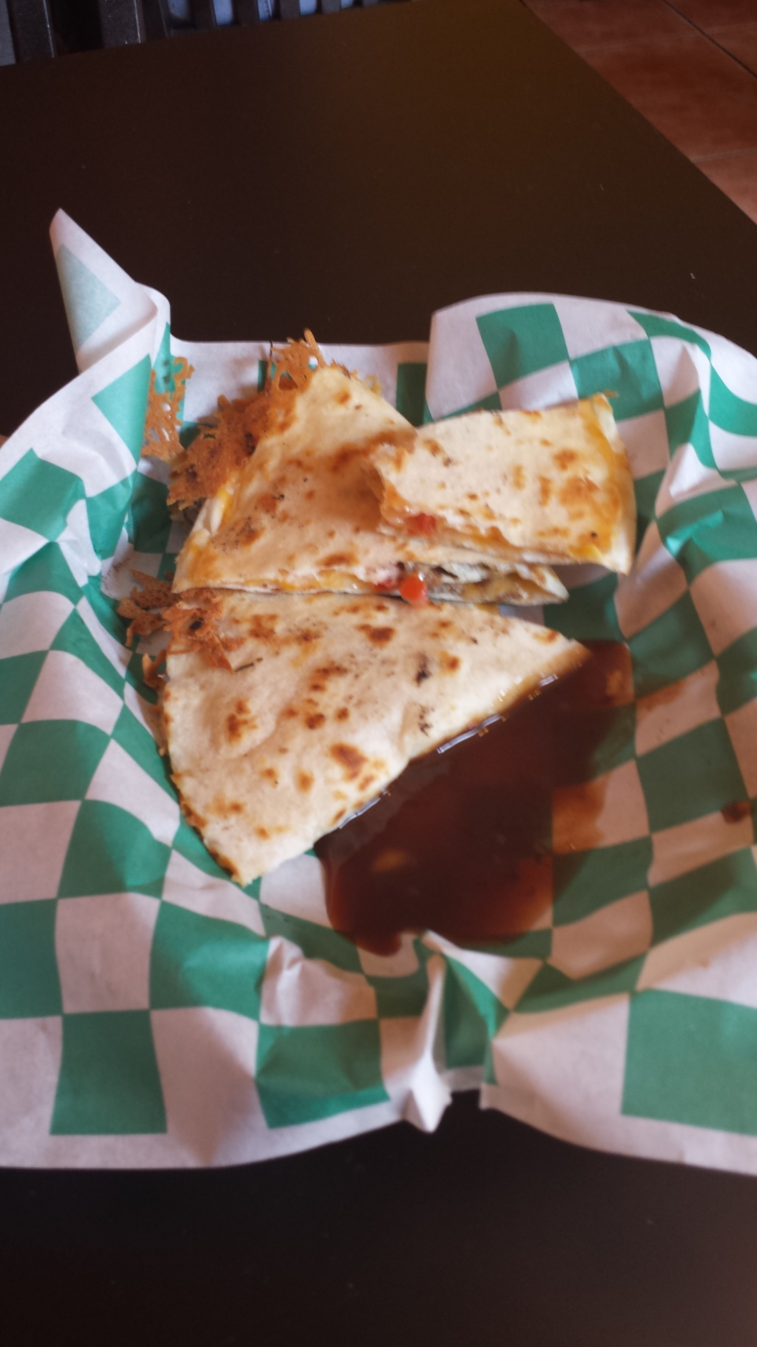 I tried to take a nice picture but couldn't help taking a few bites and smothering it with BBQ sauce as soon as I got my quesadilla.