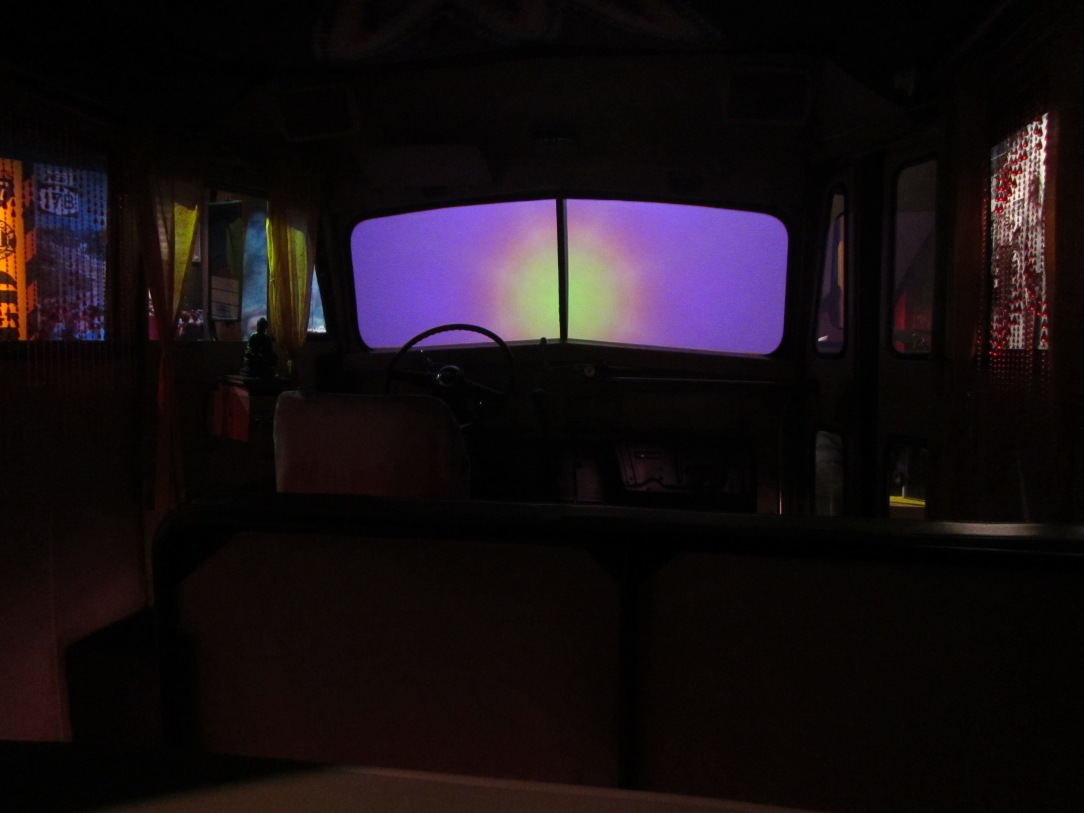 Watching some psychedelic footage in the back of the psychedelic bus.