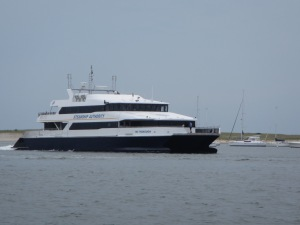 Passing a ferry on it's way back from either Martha's Vineyard, or Nantucket.